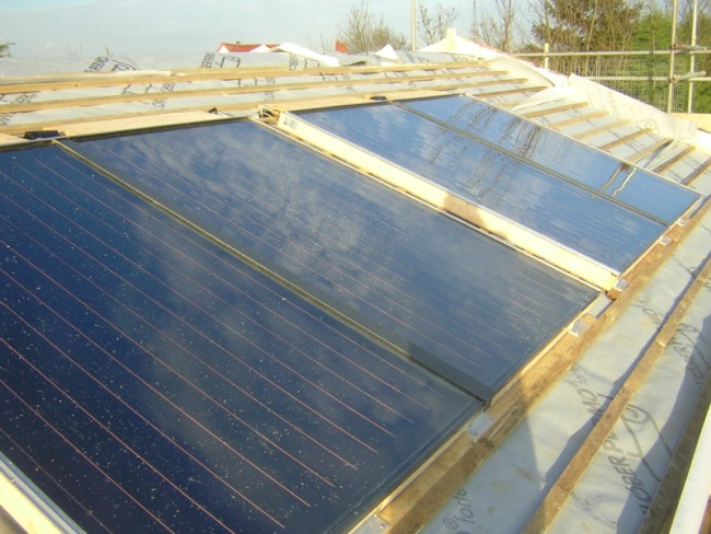 Solar Panels  fixed to roofing batons for in-roof system prior to tiling on new roof